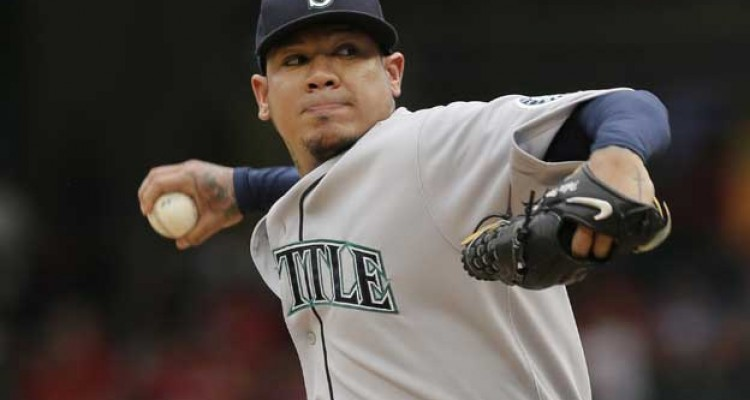 Seattle Mariners starting pitcher Felix Hernandez throws during the first inning of a baseball game against the Texas Rangers in Arlington, Texas, Sunday, Sept. 20, 2015. (AP Photo/LM Otero)