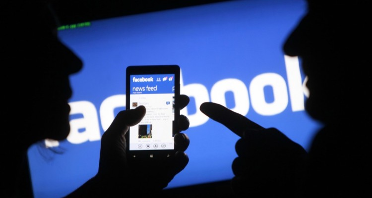 A smartphone user shows the Facebook application on his phone in the central Bosnian town of Zenica  in this photo illustration  taken May 2  2013   Facebook Inc said its systems to remove hate speech haven t worked as well as the company had hoped  amid reports that advertisers are pulling their brands off the social network in the face of a backlash from women s groups  May 29  2013   REUTERS Dado Ruvic Files  BOSNIA AND HERZEGOVINA - Tags  SOCIETY SCIENCE TECHNOLOGY BUSINESS